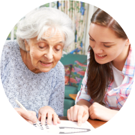 caregiver assisting an old woman