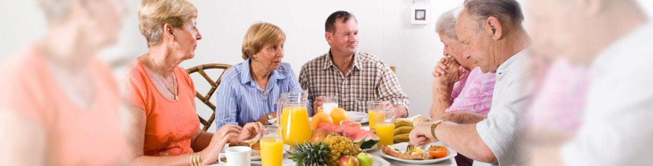 old people having fun while eating