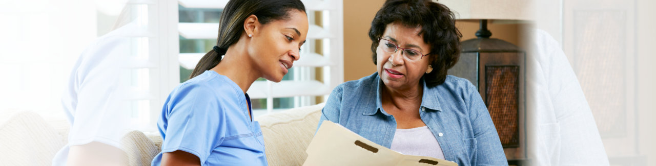 caregiver talking to an old woman